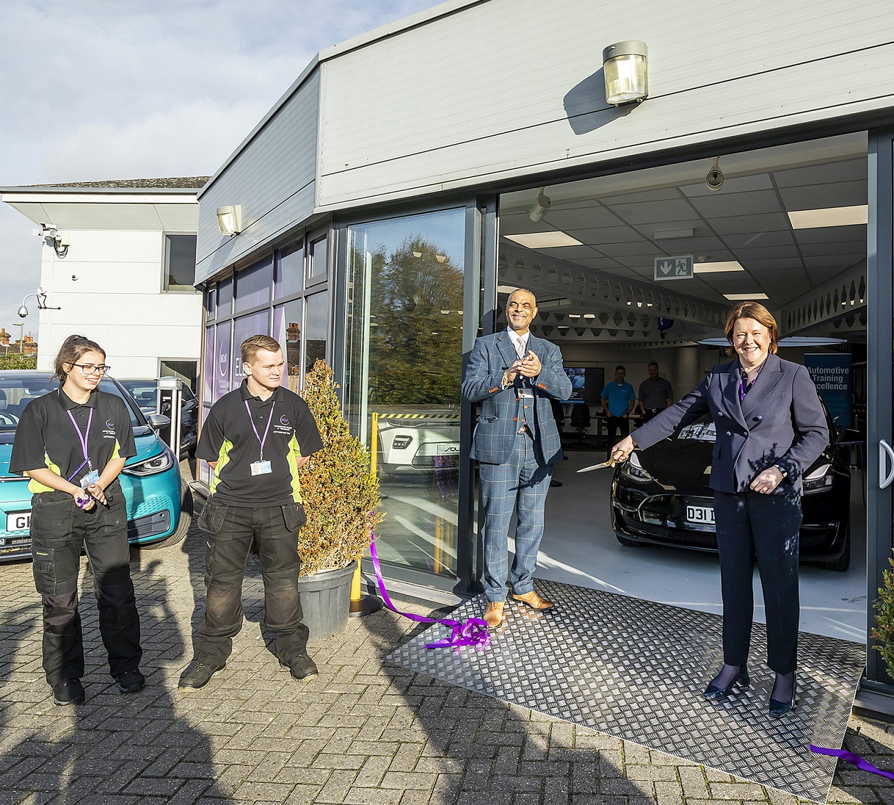 Maria Miller Basingstoke MP cuts the ribbon to officially launch the new Electric Vehicle Training Centre